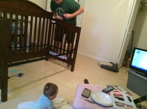 Helping Daddy with his crib...and watching football.